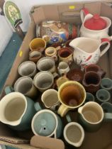 A box of assorted pottery items inc.
