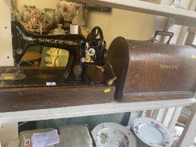 A Singer sewing machine in case
