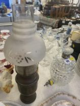A cut glass decanter and a miniature oil lamp