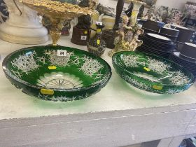 A pair of large green cut glass bowls