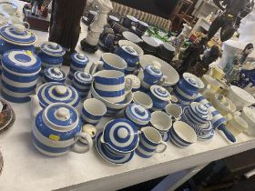 A large collection of Cornish ware and two large jelly moulds