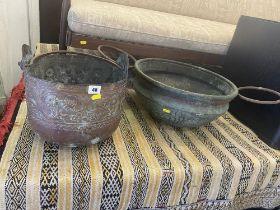 A large copper cauldron and a copper pot