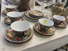 An oriental floral pattern tea set