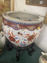 An Oriental fish bowl on stand