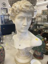 A bust of a young man