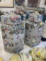 A pair of oriental lidded vases