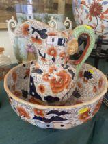 A decorative jug and bowl set