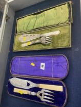 A boxed pair of silver mounted fish servers plus another