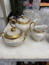 Three pieces of white and gold Mintons, teapot, sugar bowl and milk jug,