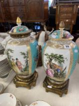 Two 19th century Porcelain and Ormulu vases, one lid a.