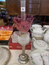 A Victorian Silver plated/ cut glass oil lamp with a Cranberry shade