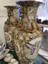 A pair of Canton style vases,
