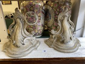 A pair of decorative wall brackets