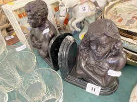 A pair of Bronze and marble bookends