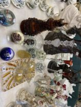A collection of glass paperweights and other items