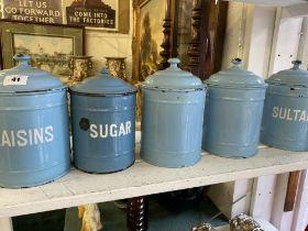 Five enamel storage tins
