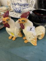A pair of Cockerel cocktail stick holders