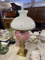 A Victorian oil lamp, brass,