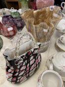 A handkerchief vase and a handbag vase