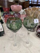 A set of eight coloured hock glasses,