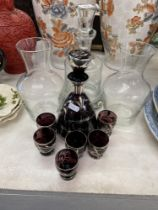 A decanter and six glasses,