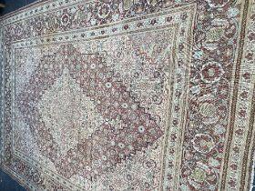 A large Persian rug, 418cms x 298cms,