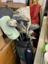 Three sets of golf clubs in bags