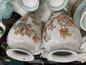 A pair of Orange and White vases