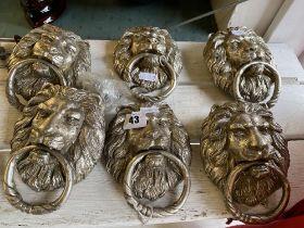 Six silvered Lions head door knockers