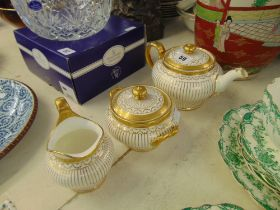 Three pieces of white and gold Mintons, teapot (has hairline inside),