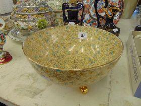 A Royal Winton three footed bowl