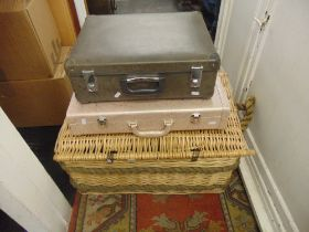 A large wicker basket and two other cases