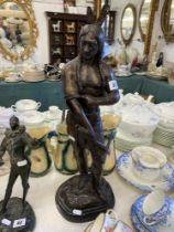 A bronze of a native American,