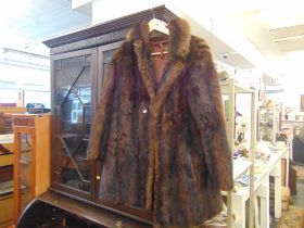 A fur stole and jacket,
