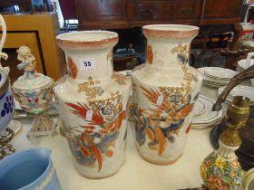 A pair of decorative Orange and White vases
