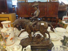 A bronze huntsman on Horse