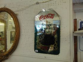 A Coca-cola advertising mirror wall clock,