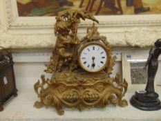 A French gilt framed Ormulu mantle clock,