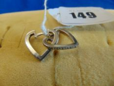A pair of White Gold Diamond set Heart shaped earrings