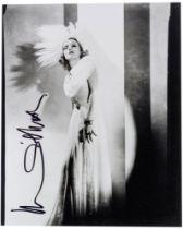 Dietrich, Marlene. Eigenhändige Signatur mit schwarzem Filzstift auf Porträt-Photographie.