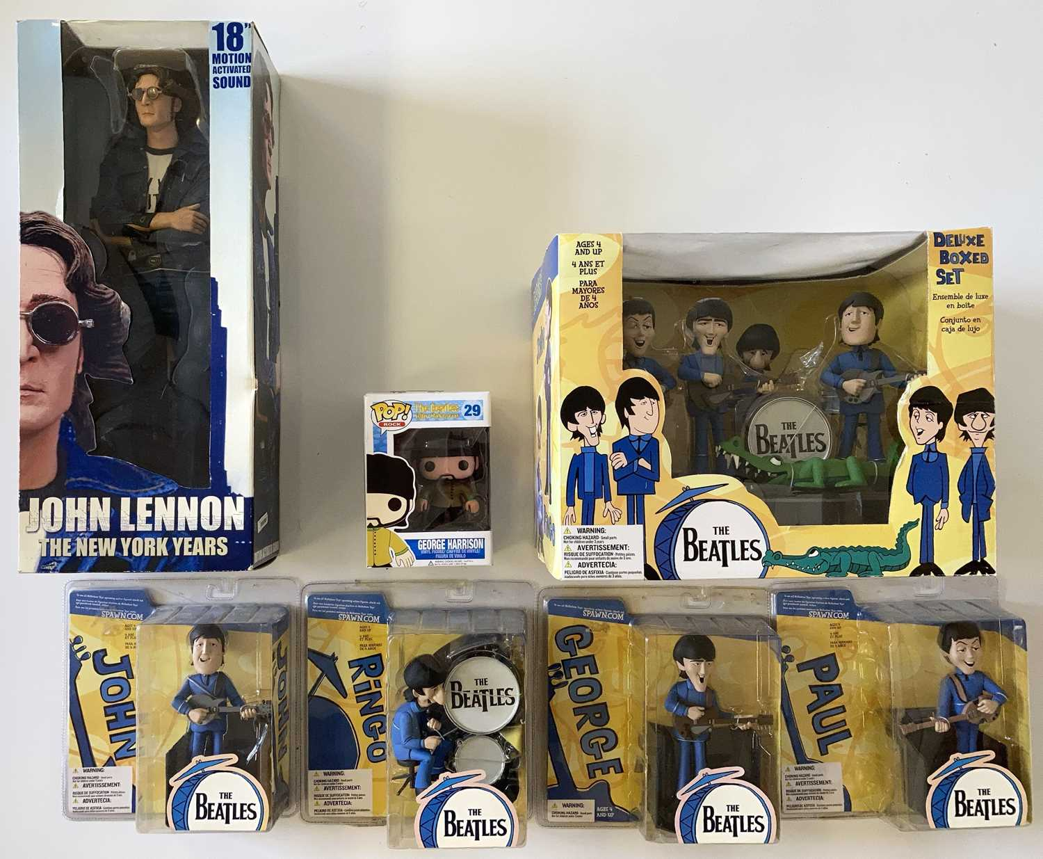 THE BEATLES FIGURINES AND TOYS IN BOXES.
