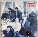 """OASIS SIGNED CIGARETTES AND ALCOHOL 7""""."""