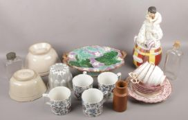 A collection of mostly 19th century ceramics to include Staffordshire figural tobacco jar, jelly