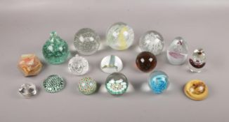 A collection of mostly glass paperweights, comprising of, a Millefiori paperweight, an Onyx multi