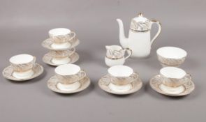 A Bone China Tea set with gilt edge detailing, Teapot, milk jug, sugar bowl, cups, saucers.