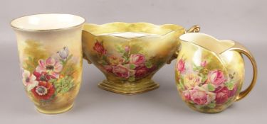 Three piece of Royal Winton Grimwades, floral design, to include two vases and a centrepiece.