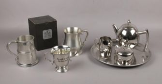 A silver plate teapot, sugar bowl, milk jug, serving tray to include two pewter tankards and AE