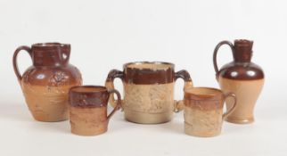 Five pieces of 19th century salt glazed stoneware with sprigged mouldings. A twin handled loving cup
