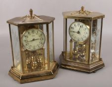 Two brass torsion anniversary clocks, one by Kundo Kieninger & Obergfell, the other by Hall Craft