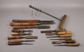 A selection of vintage wooden handled work tools, comprising of various named chisels such as